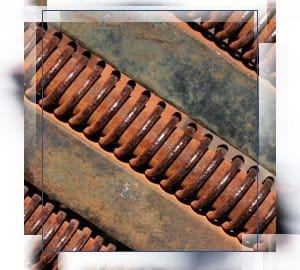 Rusted metal that standards from ASTM and NACE address
