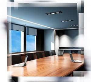 A conference room with lighting that follows office lighting standards