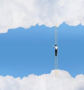 Climbing a ladder in the clouds and still following ANSI ASC A14.2-2007 for safety.