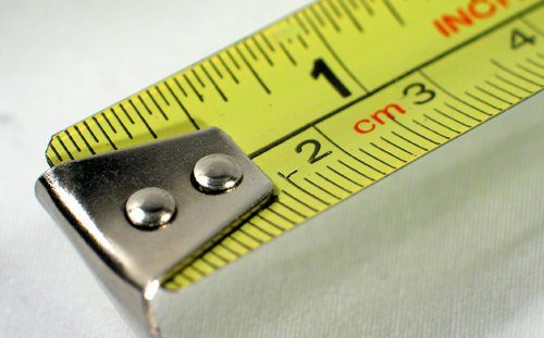 Yellow measuring tape in the standard units of measurement