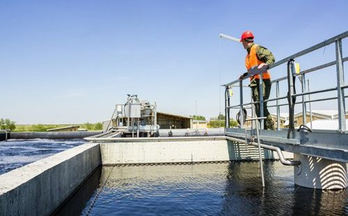 Wastewater treatment facility that follows requirements set by wastewater treatment standards