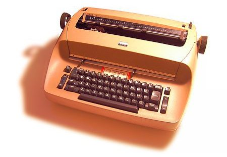 A brown IBM Selectric typewriter, which used the first backspace key.