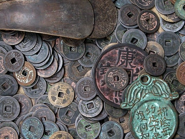 Old Chinese coins represent the history of money and how it was standardized.