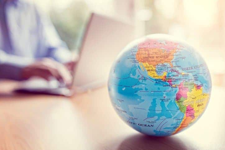 Globe on Table, a symbol of globalized economies that need standards like ISO/IEC 30113-1:2015 to operate efficiently
