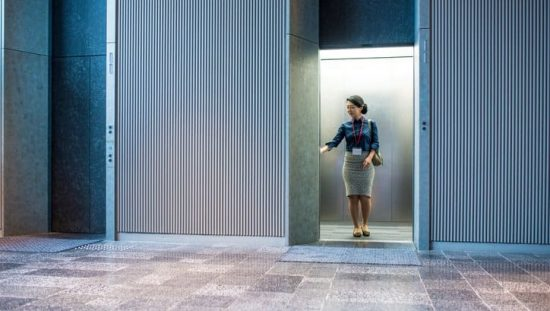 A woman in an elevator