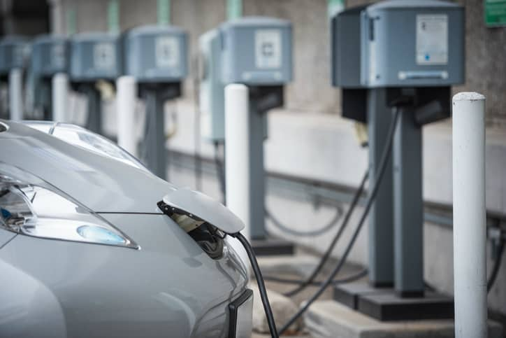 An EV plugged into an IEC 61851 electric vehicle charging system.