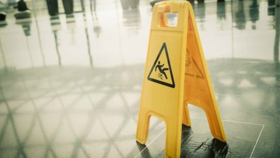 A wet surface sign put in a hotel lobby to follow ANSI ASSE A1264.1