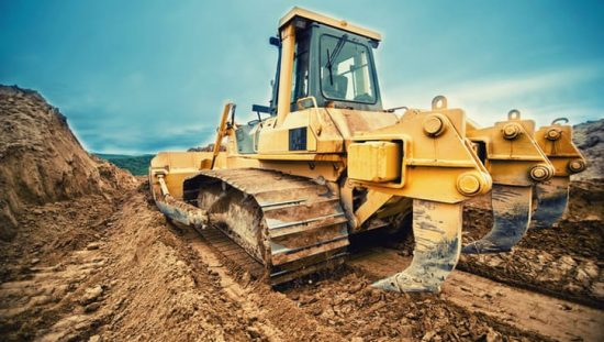 Construction equipment on a construction site complying with SAE J 1455-2017