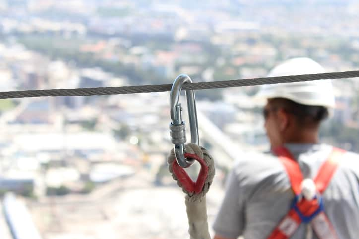 Using silver carabiner to follow ANSI/ASSE Z359.1-2016 fall protection code