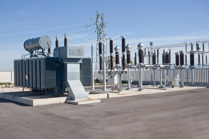 An IEEE C57.159-2016 photovoltaic transformers sitting on rooftop near solar farm.