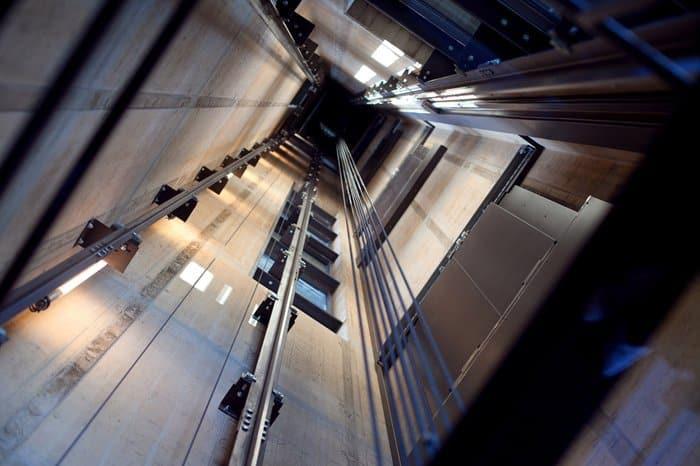 Elevator shaft with elevator designed to code