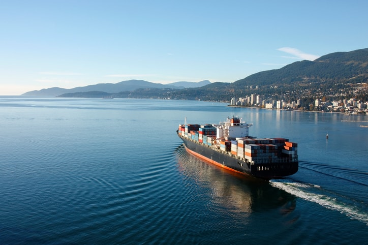 Container ship that has been tested by ASTM D4728-17 is sailing on water