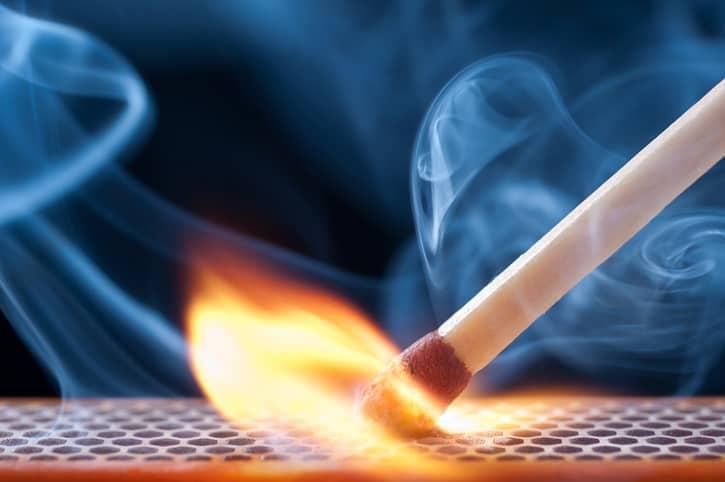 A match lighting on fire