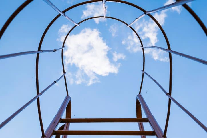Look up to the sky through a fixed ladder cage with ANSI ASC A14.3 specifications