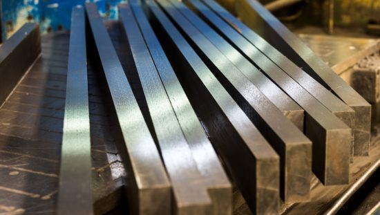 Traditional shiny steel bars that have been tested by ASTM A370-19.