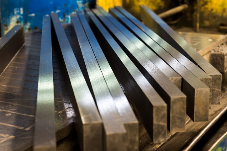 Traditional shiny steel bars that have been tested by ASTM A370-20.