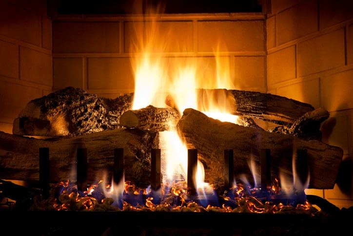 A nighttime fire is lighted in a ANSI Z21.88-2017 gas fireplace