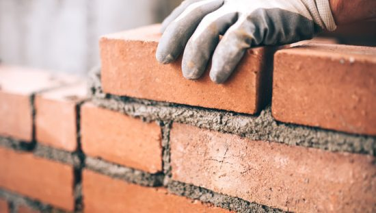 Laying brick with materials of the Unified Soil Classification in ASTM D2487-17