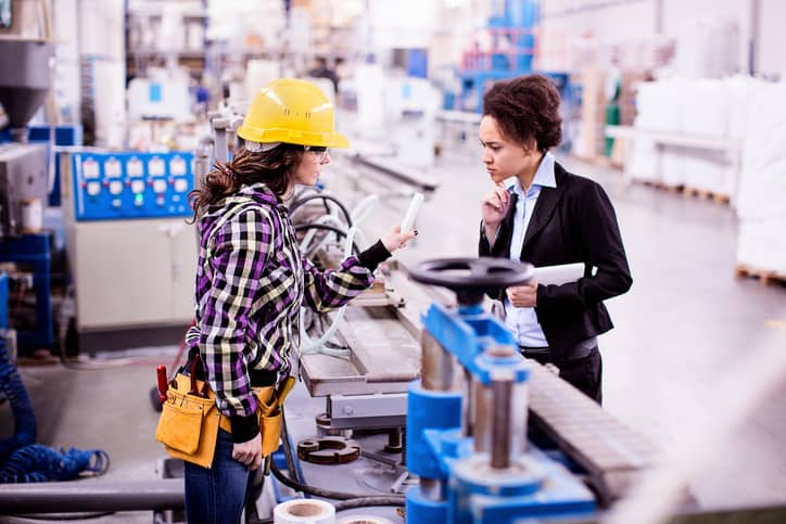A construction worker explaining a product to an adviser