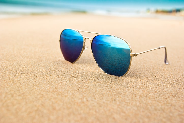 A cool pair of ANSI Z80.3:2018 sunglasses on the beach