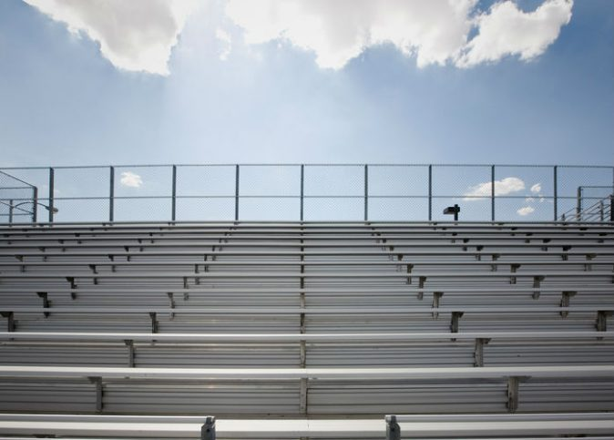 Stadium bleachers under blue sky that don't corrode thanks to ICC 300