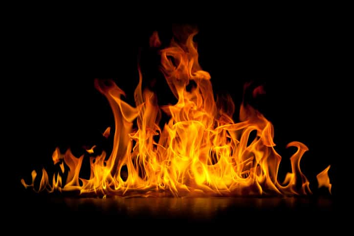 Bright fire over black background for which only ASTM F1506-20 FR and AR rated clothing can protect against.