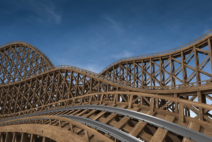 A wooden roller coaster follows ASTM F770-18 to provide safe amusement.