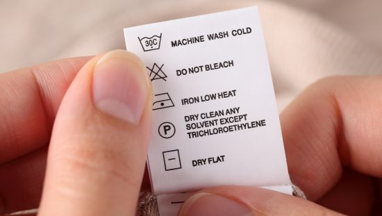 Clothes tag with laundry symbols outlined in ISO 3758:2012