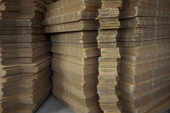 Cardboard boxes stacked after TAPPI T 830-2018 ink rub tests.