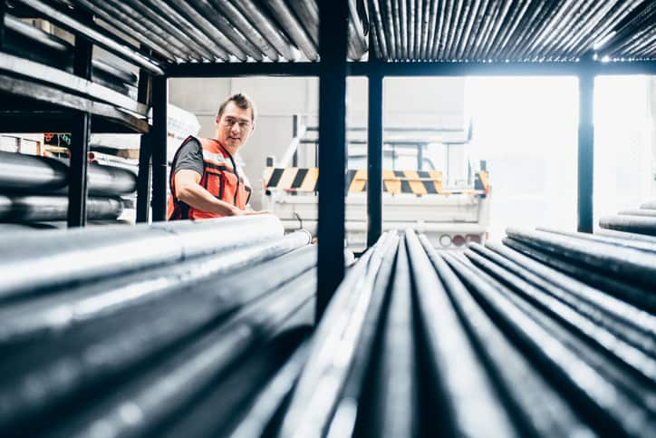 Man gazing at ASTM A513-18 Electric-Resistance-Welded Carbon and Alloy Steel Mechanical Tubing