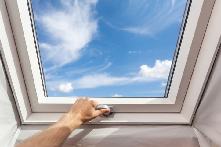 A skylight under the blue sky and clouds installed via CAN/CSA A440.4-2019 performance requirements.