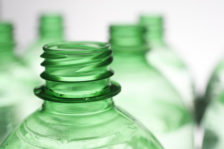 Close up of green plastic bottle with Resin Identification Code (RIC) under  ASTM D7611-18