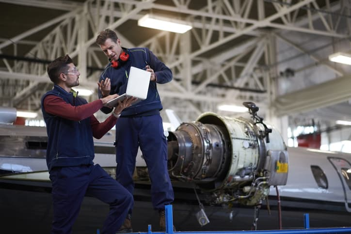 Aircraft Mechanics working with 3D technology additive manufacturing
