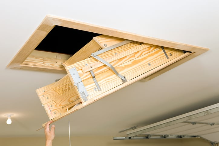 An ANSI-ASC A14.9-2019 disappearing attic stairway collapses into a ceiling.