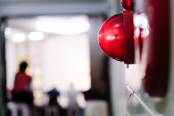 red alarm that mets testing requirements for emergency call volume