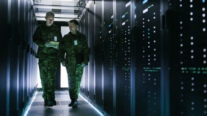 Two servicemen in uniform in server room that meets ASIS standards