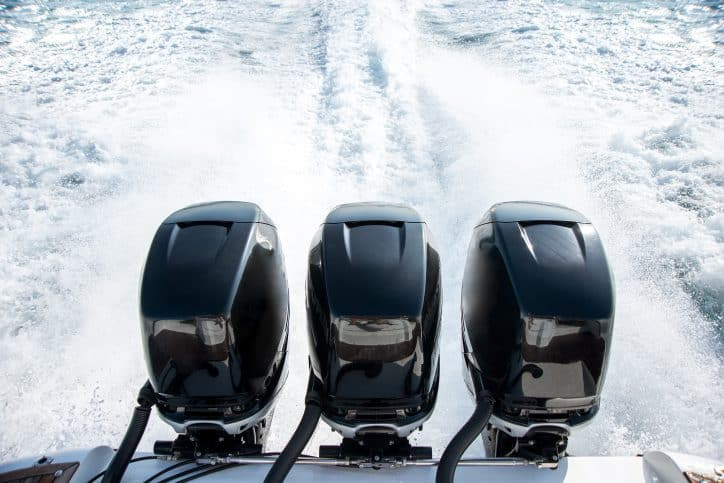 Outboard motors that meet ANSI AGMA 6032 requirements moving a boat through water