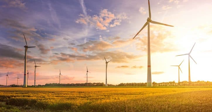 Many wind turbines in the sunset depend on the international wind turbine gearbox standard by AGMA.