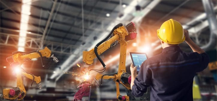 Man oversees the use of heavy machinery that meets standards published on the ANSI webstore