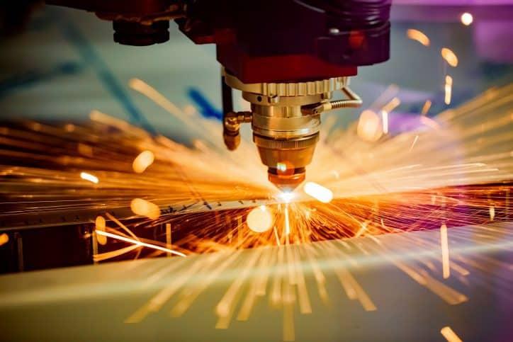 Laser that conforms to ANSI Z136.9 cutting through metal