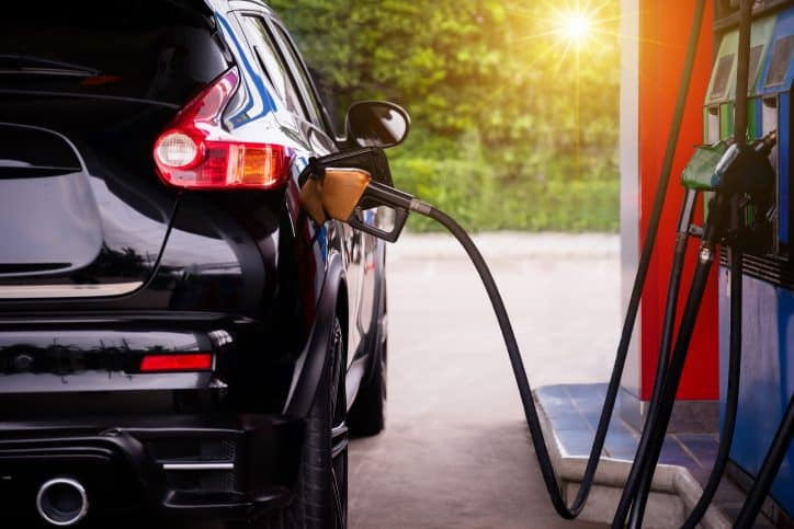 Black car at gas pump. The Outdoor Power Equipment Institute wants consumers to know about the different fuels available