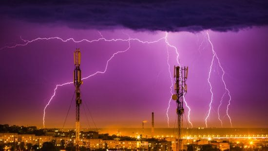 Lightning protection systems under purple sky installed with NFPA 780-2020
