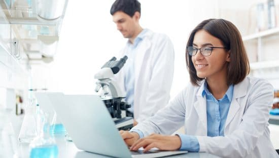 Female scientist researching tips for transitioning to ISO/IEC 17025:2017.