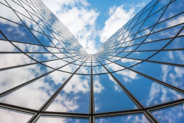 Bending building exterior beside sky following BACnet (Building Automation Control Network) under ANSI/ASHRAE 135.