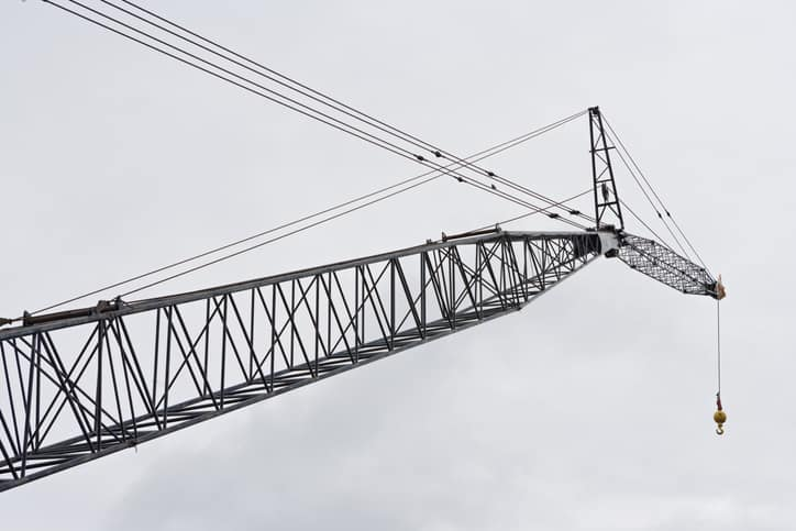 Crane with the hook on the end that follows safety guidelines set in ASME B30.10