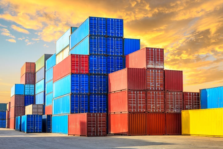 Stacked colorful series 1 freight containers, as classified by ISO 668:2020.