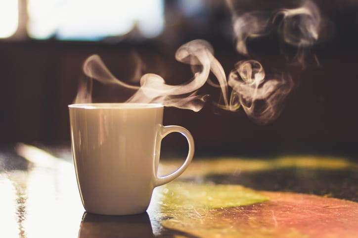 Steam rising from sumptuous coffee cup as someone prepares for ISO/IEC 17025 ANAB Online Accreditation-Related Training