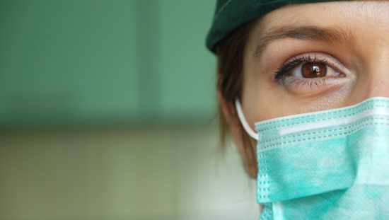 Woman wearing a medical face mask designed to ASTM F2100-20.