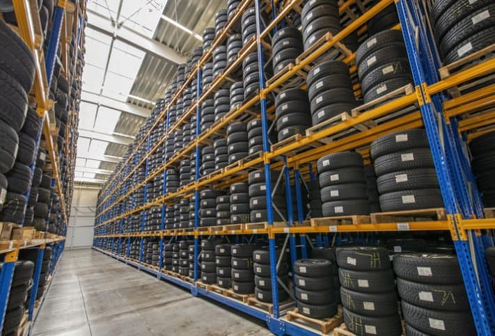Stacked tires on yellow shelves tested to SAE J 175-2020