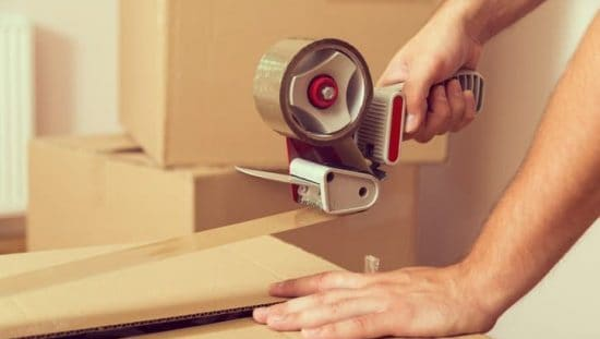 Testing out the peel adhesion of tape with ASTM D3330 over a packaging box